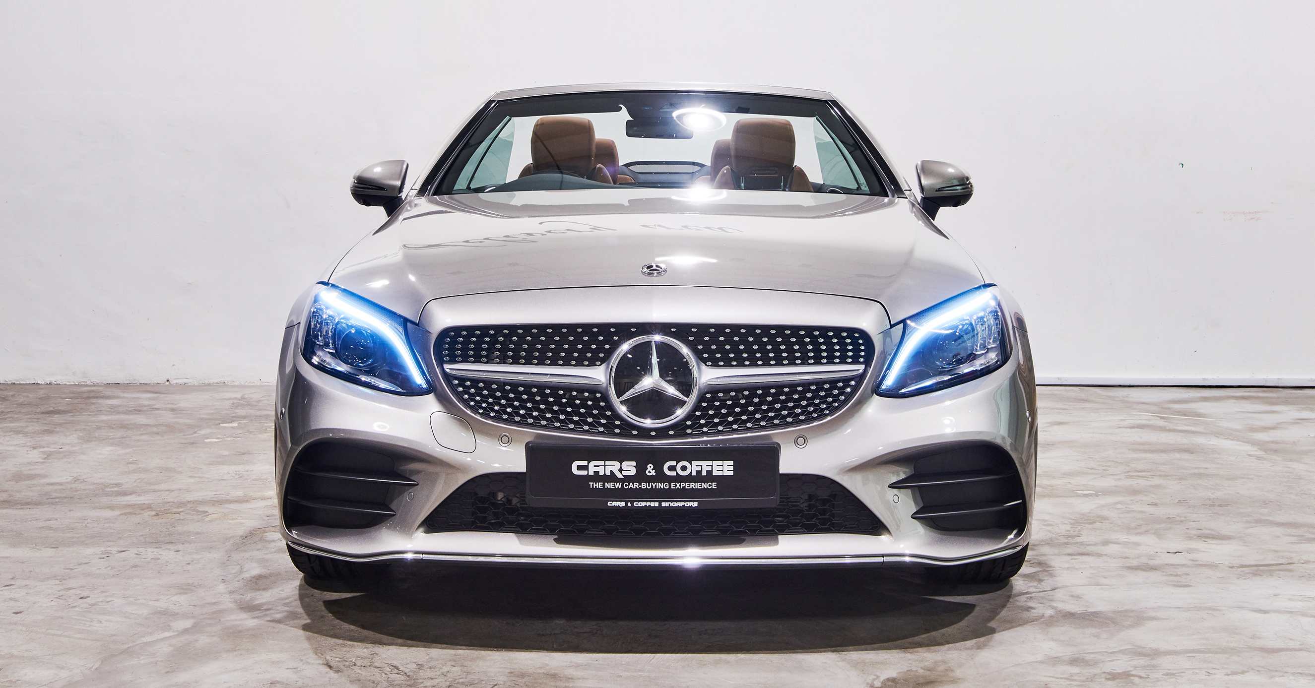 Beyond a seasonable doubt. The New C-Class Cabriolet shows an ever-fresh face to the sun. There's room for four to take in the sky or ride in coupelike comfort under the rich fabric top. And everywhere you look or touch, you feel a unique heritage of motoring into tomorrow.