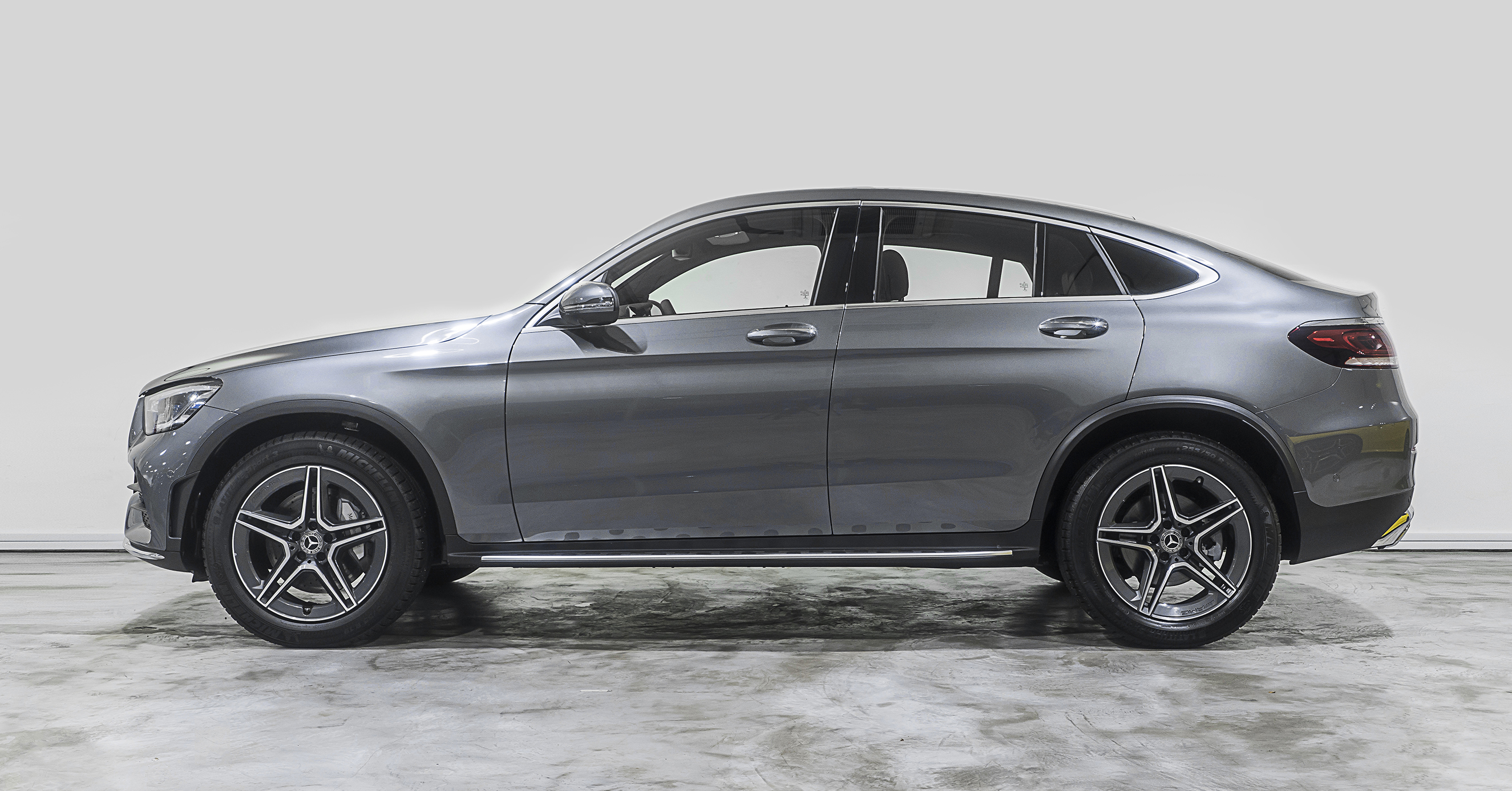 "You don't count doors to define a Mercedes-Benz coupé. Character is what counts. Agile, strong, and sleek, the GLC Coupé puts the ""stance"" in substance. Fresh styling, from the grille and LED headlamps to its three-dimensional LED taillights, gives it new shine."